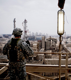 A US soldier looks over the Baiji Refinery in Baiji, Iraq, December 16, 2009. (Photo: Ayman Oghanna / The New York Times)
